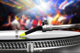 Fototapety dj turntable with vinyl record in the dance club
