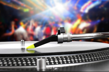 dj turntable with vinyl record in the dance club