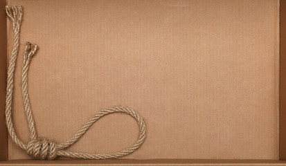 Rope on cardboard texture background