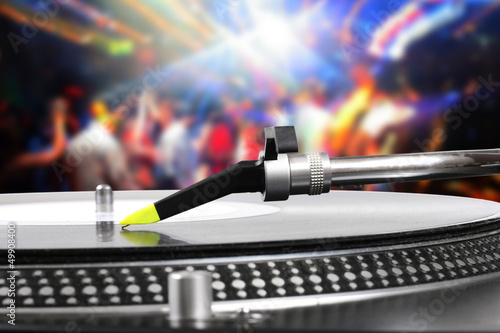 Fridge magnet dj turntable with vinyl record in the dance club