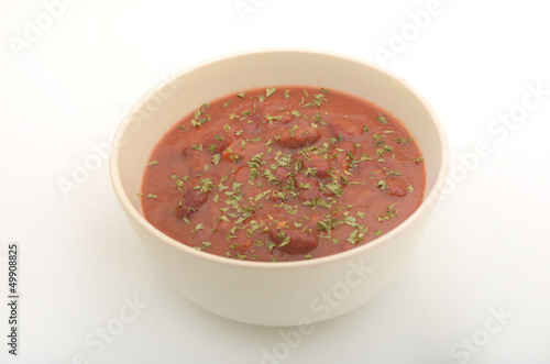 Bowl of vegetarian chili with garnish