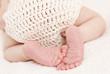 Cute baby feet close-up