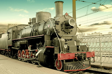 Old steam locomotive at station