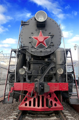 Old steam locomotive against blue sky