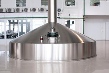 Fermentation vats on brewery plant