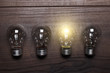 bulb uniqueness concept on wooden background