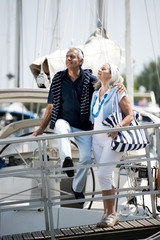 Mature couple enjoying a stroll at a marina
