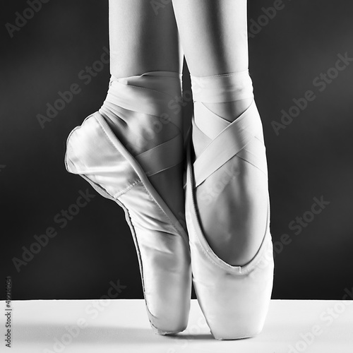 A photo of ballerina's pointes on black background © stolbik84