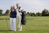 Mature couple on golf course