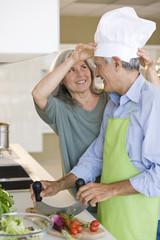Mature couple preparing food