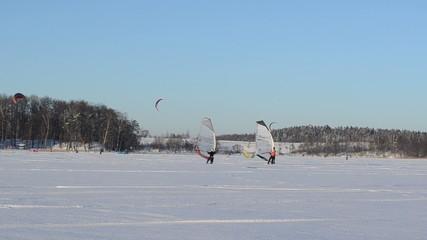 ice surfers men sail frozen lake snow extreme sport
