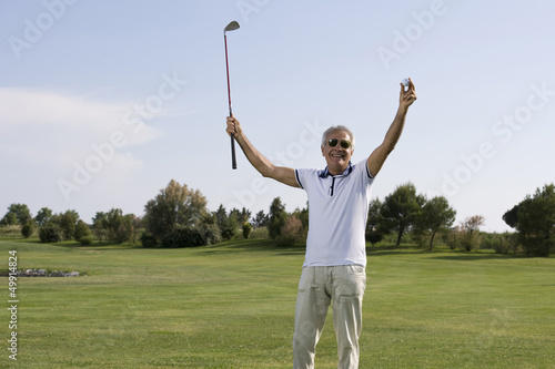 Mature man playing golf