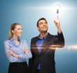 man and woman with light bulb