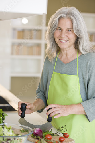 Mature woman preparing food