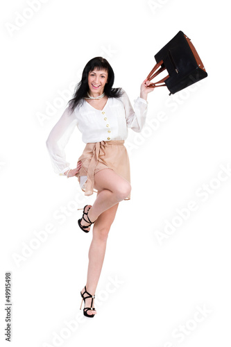 Happy shopping woman jumping with bag