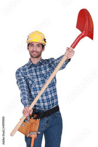Builder handing over shovel