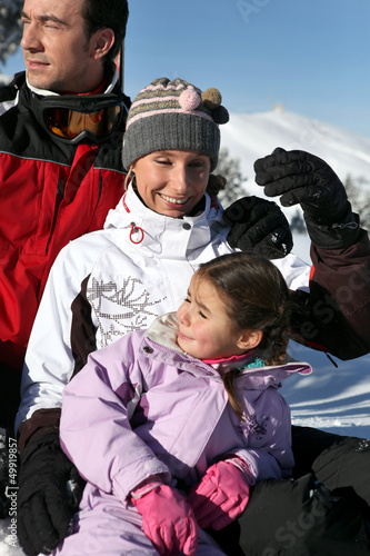 Family enjoying skiing trip
