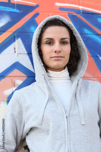 Woman in a hooded sweatshirt