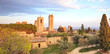 San Gimignano landmark medieval town on sunset, towers and park.