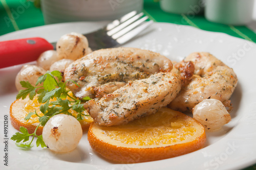 Chicken steak with fried oranges and onion
