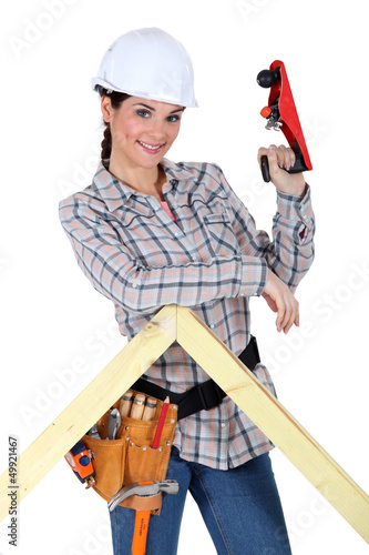 Woman using wood plane