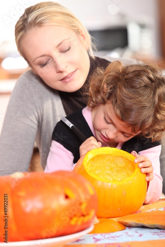 girl painting pumpkin