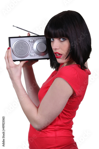 Lady in red listening to a radio