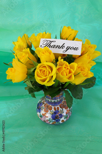 Thank you note and yellow roses