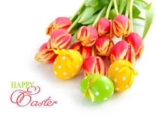 Easter eggs with tulips on white background