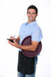 Casual waiter with tray and notepad