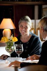 Mature couple dining in an elegant restaurant