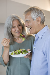 Mature couple eating salad