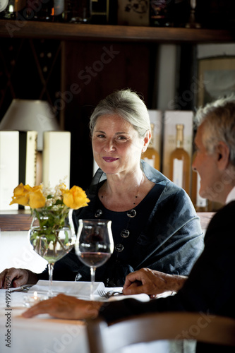 Mature couple dining in an elegant restaurant