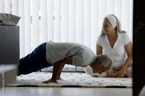 Mature couple doing yoga