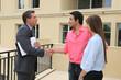 Estate agent shaking customers hand