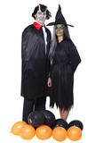 Couple disguised in vampire and witch