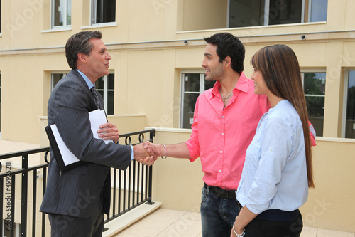 Estate agent shaking customers hand