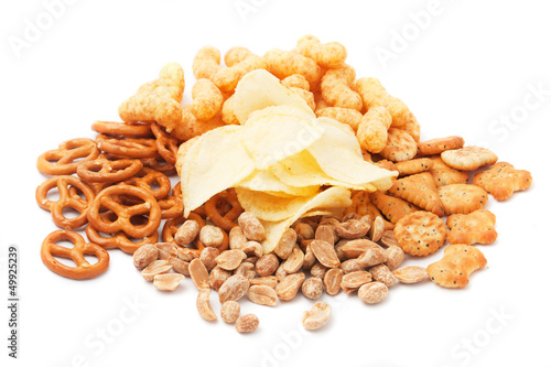 Salty snacks isolated on white
