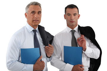 Two businessmen stood with folders
