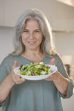 Mature woman holding bowl of salad