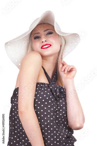 Attractive woman with hat smiling, isolated on white