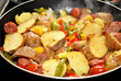 Frying Kielbasa, Potatoes and Peppers