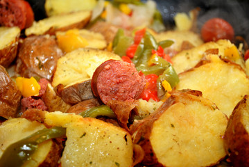 Cooking Sausage with Potatoes and Fresh Peppers