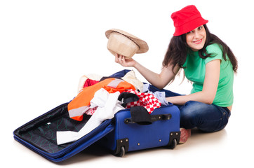 Young girl packing for vacation