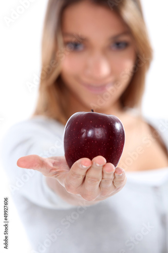 portrait of a woman holding an apple