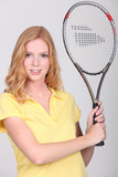 teenager holding a tennis racket