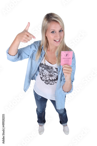 Blond teenager with driving license