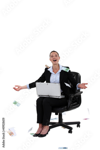 Overjoyed woman throwing money in the air