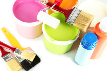 Set for painting: paint pots, brushes, paint-roller close up