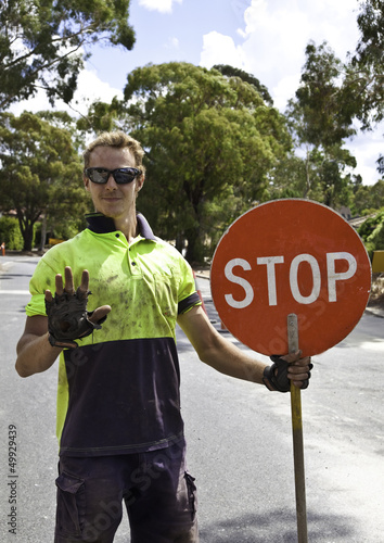 Roadworker controls traffic flow